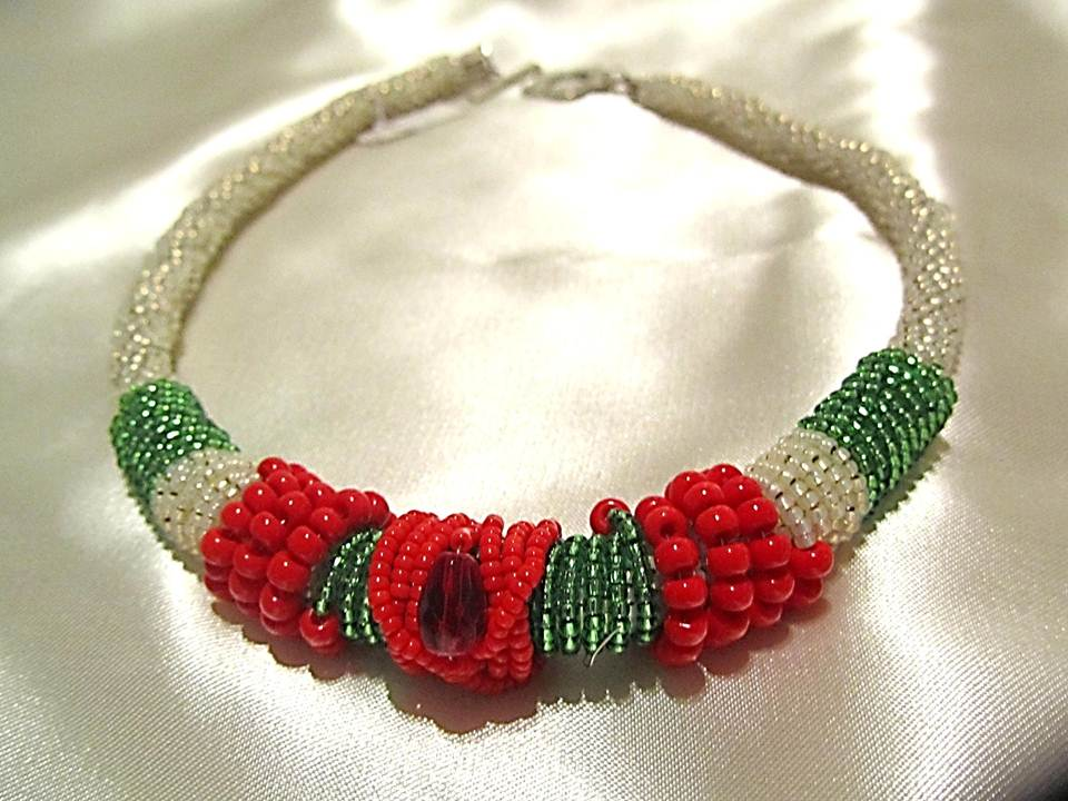 wrapped white necklace with red and green beads