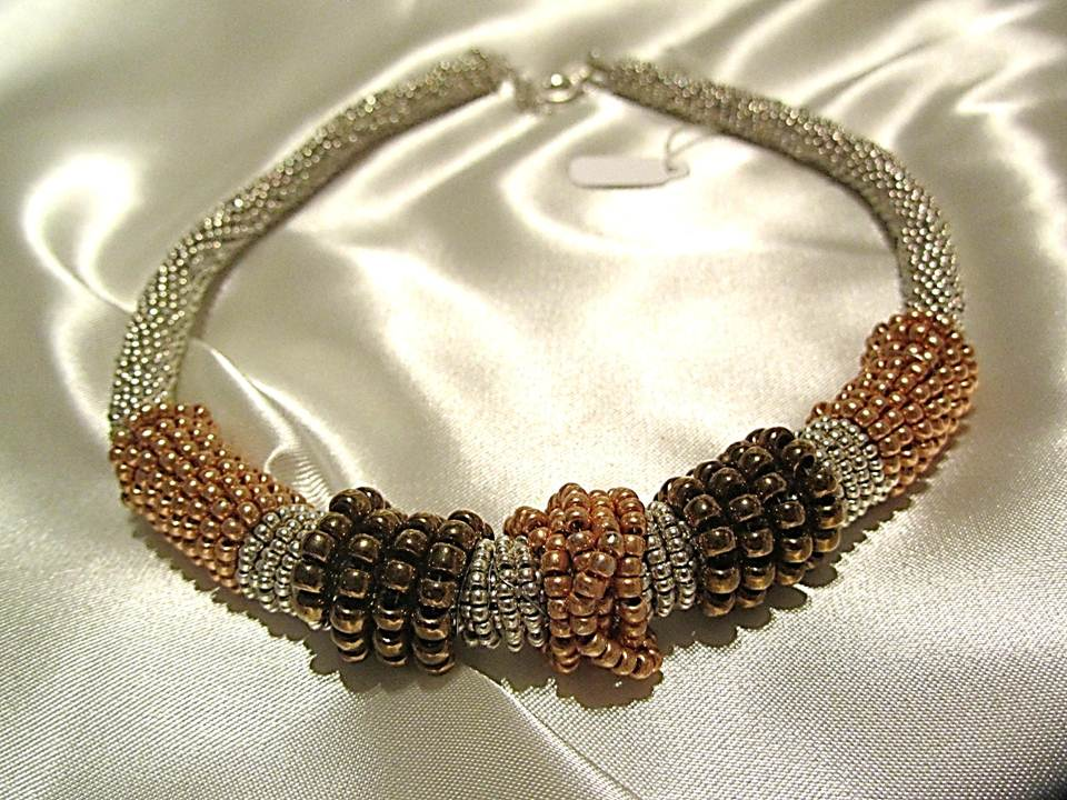 wrapped 0ff white necklace with gold and brown beads